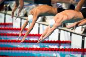Men start swimming race — Stock Photo