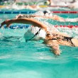 Freestyle  women race in swimming pool — Stock Photo #64505477