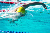Freestyle race in swimming pool — Stock Photo