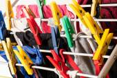 Mixed  clean laundry pinned with colourful clothespins — Stock Photo