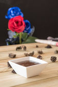 Chocolate pudding with strawberries and roses background — Photo