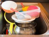 Huge heap of dirty dishes waiting for the flatmate — Stock Photo