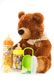 Teddy bears and baby bottles and pacifiers for a child — Stock Photo