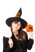 Girl dressed as a witch on a white background — Stock Photo