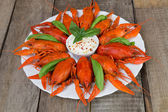 Plate with red boiled crayfish and herbs — Stock Photo