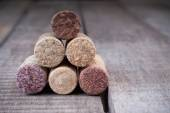 Close up of stacking corks for wine bottles on a wooden background — Stock Photo