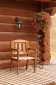 Wood chair wood house flowers — Stock Photo