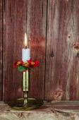 A burning christmas decorated candle  — Stok fotoğraf