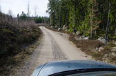 Driving at a gravel road — Stock Photo