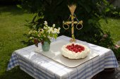 Homemade cake at a decrated table — Stock Photo