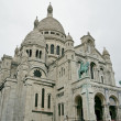 Sacre Coeur Basilica of the Sacred Heart of Jesus Montmartre in — Stock Photo #61450759