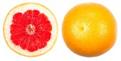 Whole grapefruit and cuted isolated on a white — Stock Photo