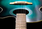 Acoustic guitar, black and green color — Stock Photo