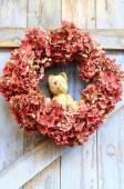 Vintage teddy bear heading among autumn leaves — Stock Photo