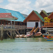 Housing on piles. Sea Gypsy Village Koh Panyee in the Andaman Sea, Thailand — Stock Photo #64100823