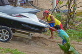 Phuket,TH-Sept,24 2014: Removal of the scooter from the Karon beach. Phuket, Thailand — Stock Photo