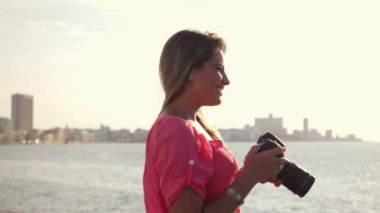 1of3 Woman, female photographer, happy tourist smiling, picture, travel, sea — Stock Video