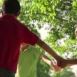 15of18 Children playing ring around rosie, young people, fun, park — Stock Video #56069355
