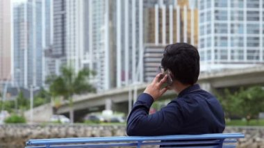 10of10 Asian businessman, chinese manager, man talking on mobile telephone — Stock video