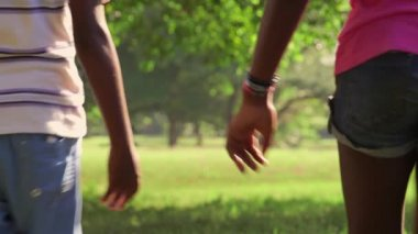 12of18 School boy and girl, couple running together in park — Stock Video