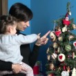 Family With Happy Mom And Child Looking At Christmas Tree — Stock Video #60341619