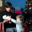 Mother And Child Open Christmas Present Gift During Winter Holidays — Stock Video #60344395