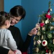 Happy Mother And Daughter Looking At Christmas Tree At Home — Stock Video #60344987