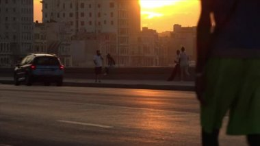 Cuba La Habana Havana Malecon At Sunset With People And Old Cars 4K — Stock Video