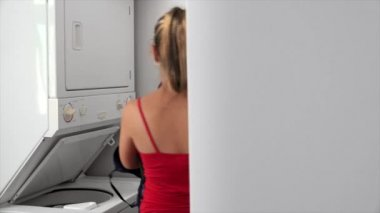 Woman Washing Dirty Clothes In Laundry Machine — Stock Video
