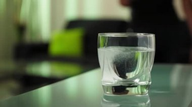 Sick Woman Puts Effervescent Tablet Aspirin In Glass Of Water — Stock Video