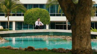 Businessman Meditating Doing Yoga Outside Office Building — Stock Video