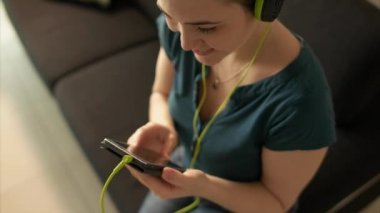 Woman With Mobile Phone Listens Music Podcast Earphones — Stock Video