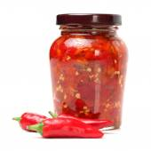 Fresh red chilly and bottled chili sauce — Stock Photo