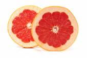Grapefruit with segments on a white background — Stock Photo