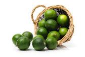 Fresh limes on white — Stock Photo