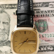 Dollars money banknotes and watch — Stock Photo #67484459