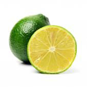 Whole and sliced fresh limes — Foto de Stock