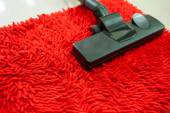 Vacuum cleaner on Red Carpet — Stock Photo
