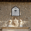 Постер, плакат: Sundial and coat of arms in Villafranca del Bierzo