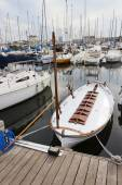 Wooden vintage boat moored in the pier. — Stock Photo