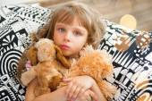 Little girl holding a soft toys at home. — Stock Photo