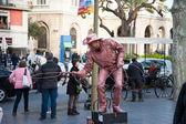 Street Performer imitating bronze statue — Stock Photo