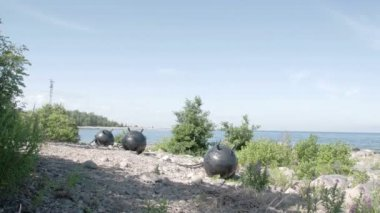 Three big sea mines found on the rocky shore of the sea FS700 Odyssey 7Q — Stock Video