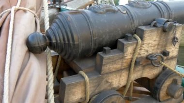 A small cannon handicraft on the boat on dock  GH4 — Stock Video