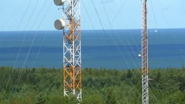 Two tall telecommunication towers in the middle of the field GH4 — Stock Video
