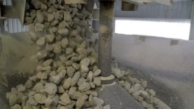 Rocks dropping from a conveyor — Stock Video