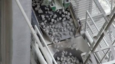 Rocks slowly dropping from a conveyor — Stock Video