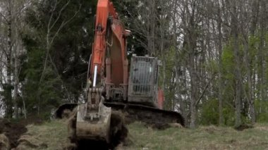 A red backhoe — Stock Video