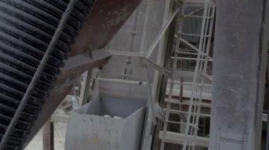 A conveyor machine loading stones — Stock Video