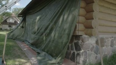 Constructed cabin covering with big cloth — ストックビデオ